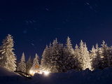 Stars in the Sky Above a House in a Snowy Forest Photographic Print by Oliver Borchert