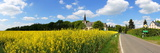 Church and Rape Field in Buchholz in the Eifel Photographic Print by Beate Tuerk