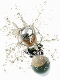 Cork Flying Out of a Sparkling Wine Bottle Photographic Print by  Kröger & Gross