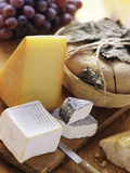 Assorted Cheese on a Cutting Board Photographic Print