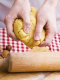Hands Kneading Biscuit Dough Photographic Print by Robert Kneschke