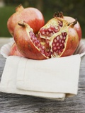 Pomegranates, Whole and Halved, on Cloth in White Bowl Photographic Print