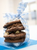 Macadamia-Chocolate Cookies Filled with Chocolate Mousse Photographic Print by Ulrike Kohl