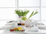A Table Laid for Breakfast with White Tulips and Fruit Photographic Print by Karin Hessmann