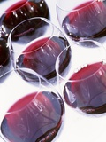 Six Glasses of Red Wine Against White Background Photographic Print by Linda Burgess