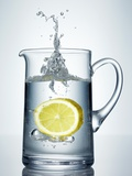 Lemon Falling into Jug of Water Photographic Print by Petr Gross