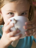 Young Girl Drinking a Cup of Hot Chocolate Photographic Print