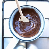 Pan of Melted Chocolate on a Cooker Photographic Print by Dave King