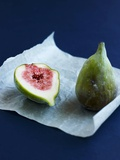Whole Fig and Half a Fig on Parchment Paper Photographic Print by Geoff Fenney