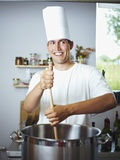 Laughing Chef Stirring Pan Photographic Print by Robert Kneschke