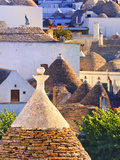 Italy, Apulia, Bari District, Itria Valley, Alberobello, Trulli (Typical Houses) Photographic Print by Francesco Iacobelli