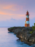 Folly Point Lighthouse Illuminted at Dusk, Port Antonio, Portland Parish, Jamaica, Caribbean Photographic Print by Doug Pearson