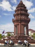 Motorcycles Passing Independence Monument, Phnom Penh, Cambodia Photographic Print by Ian Trower