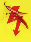 A Sliced-Open Chilli Pepper on a Red Arrow Photographic Print by Bodo A. Schieren