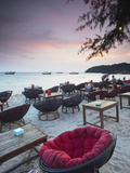 Beach Restaurants at Dusk on Ochheuteal Beach, Sihanoukville, Cambodia Photographic Print by Ian Trower