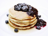 A Pile of Pancakes with Blueberry Sauce and Maple Syrup Impressão fotográfica por Gerrit Buntrock