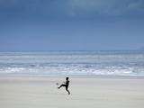 Brazil, Maranhao, Sao Luis, Sao Marcos Beach, Boy Playing Football on the Beach Photographic Print by Alex Robinson