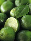 Limes, Several Whole and One Halved Photographic Print by Vladimir Shulevsky