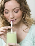 Woman Drinking Cucumber Shake Through a Straw Photographic Print