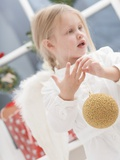 Small Girl with Angel's Wings Holding Christmas Bauble Photographic Print
