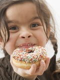 Girl Holding a Doughnut with Sprinkles, Partly Eaten Photographic Print