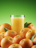 Orange Juice and Fresh Oranges Photographic Print by Miguel G. Saavedra