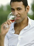 Young Man Drinking a Glass of Rosé Wine Photographic Print by Jolanda Cats