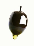 Olive Oil Dripping from an Olive Photographic Print by Dieter Heinemann