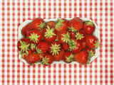 Fresh Strawberries in Cardboard Punnet Photographic Print by  Kröger & Gross