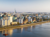 North Korea, Pyongyang, Elevated City Skyline Including the Ryugyong Hotel and Taedong River Photographic Print by Gavin Hellier