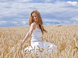Young Woman in Barley Field Photographic Print by Marco Müller