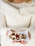 Girl Holding Jam Biscuits on Napkin Photographic Print