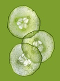 Three Slices of Cucumber on a Green Surface Photographic Print by Steven Morris