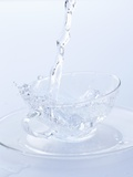 Pouring Water into a Glass Cup Photographic Print by Marc O. Finley