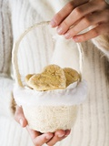 Hands Holding Almond Biscuits in Small Basket (For Christmas) Photographic Print