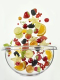 Various Fruits Falling into Glass Bowl Photographic Print by Jürgen Holz