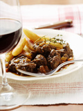 Venison Ragout with Potato Noodles and Thyme; Red Wine Glass Photographic Print