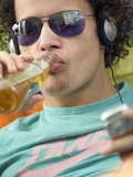 Youth Drinking Beer and Listening to Music Photographic Print by Jolanda Cats