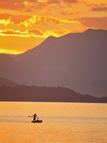 Brazil, Rio De Janeiro State, Angra Dos Reis, Ilha Grande, a Fisherman Silhouetted Against the Suns Photographic Print by Alex Robinson
