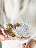 Hands Holding Glass Bowl of Assorted Gingerbread Biscuits Photographic Print