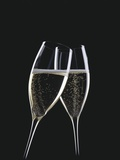 Two Glasses of Sparkling Wine Being Clinked Together Photographic Print