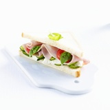 A Ham, Camembert, Tomato, Cucumber and Basil Sandwich Photographic Print by Kai Schwabe