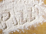 The Word 'PIZZA' Written in Flour Photographic Print by Yehia Asem El Alaily
