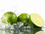 Limes with Splashing Water Photographic Print by Michael Löffler
