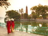 Girls Wearing Ao Dai Dress, Tran Quoc Pagoda, West Lake (Ho Tay), Hanoi, Vietnam Photographic Print by Jon Arnold