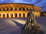 France, Provence, Nimes, Roman Ampitheatre, Toreador Statue at Dusk Photographic Print by Shaun Egan