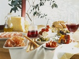 A Table Laid with Antipasti and Red Wine Photographic Print by Ulrike Koeb