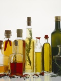 Various Types of Oil in Bottles Photographic Print by Ulrike Koeb