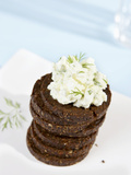 A Pile of Pumpernickel Rounds with Herb Quark Photographic Print