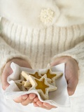 Woman Holding Star-Shaped Biscuits Photographic Print